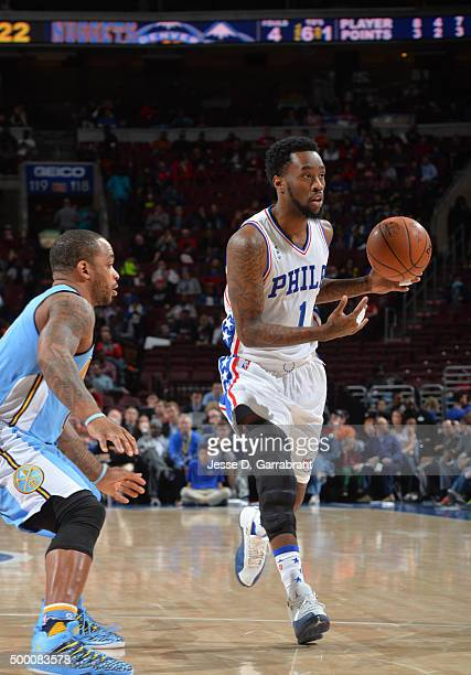Tony Wroten the Philadelphia 76ers controls the ball against the Denver Nuggets at Wells Fargo Center on December 5 2015 in Philadelphia Pennsylvania...
