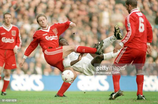 Tony Yeboah of Leeds United attempts an overhead kick whilst being challenged by John Scales and Phil Babb of Liverpool during an FA Cup Quarter...