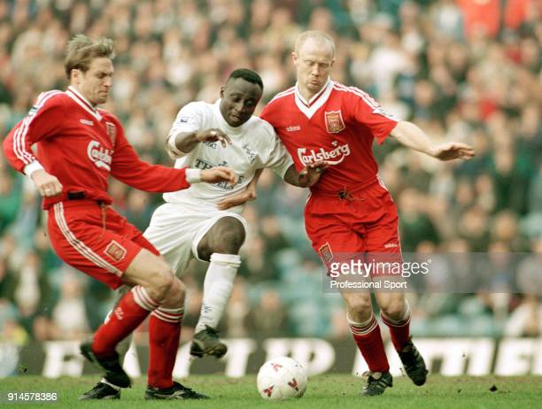Tony Yeboah of Leeds United is challenged by John Scales and Mark Wright of Liverpool during an FA Cup Quarter Final at Elland Road on March 10 1996...