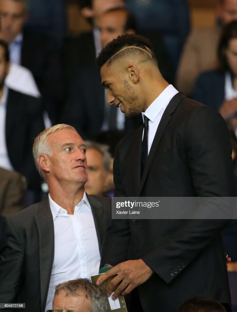 Tony Yoka and Didier Deschamps attend the UEFA Champions League group A between Paris Saint-Germain and Arsenal FC at Parc Des Princes on september 13, 2016 in Paris, France.
