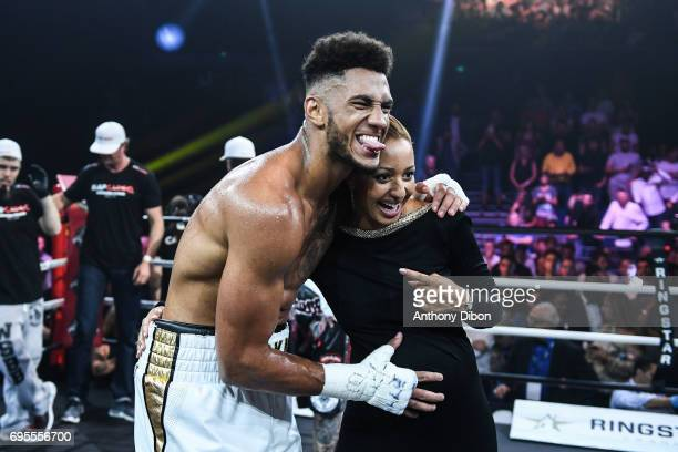 Tony Yoka celebrates his victory with her wife Estelle Mossely during the boxing event la conquete at Palais des Sports on June 2 2017 in Paris France