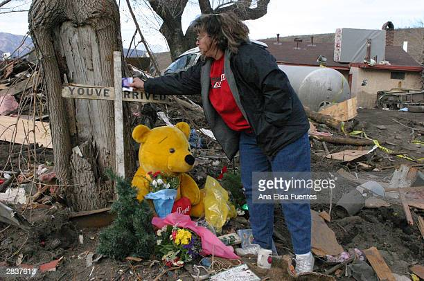 Tonya Best places a photo of her deceased mother Janice Bradley at a memorial site on the KOA campground December 30 2003 in San Bernardino...