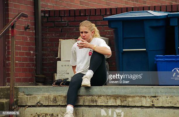 Tonya Harding drinking coffee outside a community center where she was doing courtordered service after her conviction