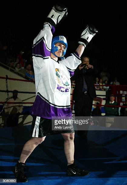 Tonya Harding enters the ring for a boxing exhibition during the second period intermission at the Colorado Eagles versus Indianapolis Ice hockey...