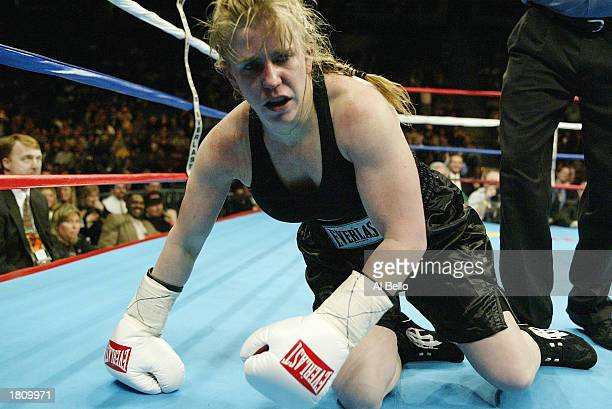 Tonya Harding falls to the floor during her fight with Samantha Browning in a second round during their women's bantamweight bout at The Pyramid on...