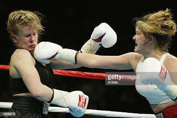 Tonya Harding is hit by a right jab from Samantha Browning during their women's bantamweight bout at The Pyramid on February 22 2003 in Memphis...