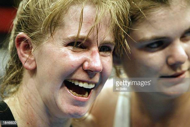 Tonya Harding poses with Samantha Browning after their women's bantamweight bout at The Pyramid on February 22 2003 in Memphis Tennessee Browning won...