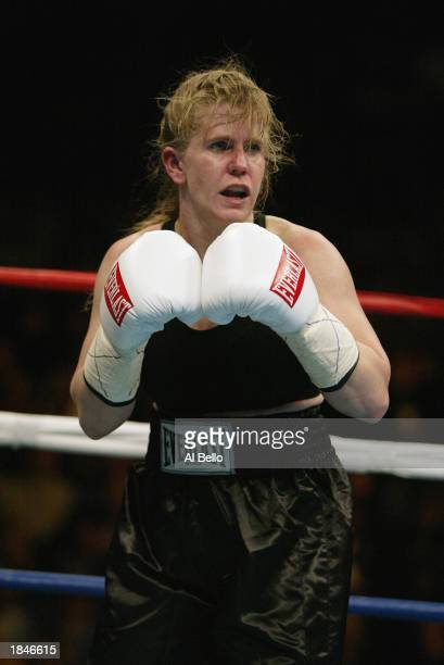 Tonya Harding waits on Samantha Browning during their women's bantamweight bout at The Pyramid on February 22 2003 in Memphis Tennessee Browning won...