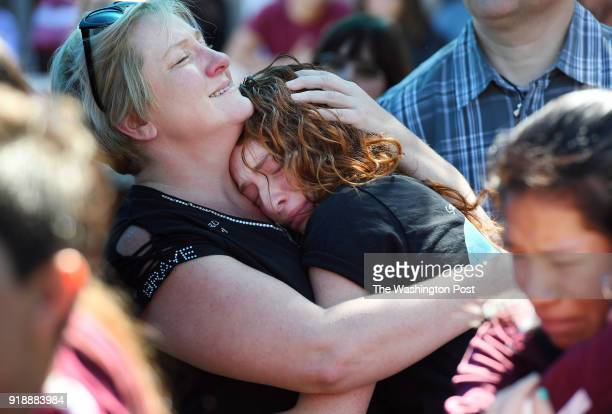Tonya Kramer center embraces her daughter Alyssa Kramer during a community prayer vigil for Marjory Stoneman Douglas High School shooting at...
