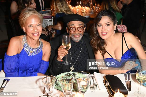 Tonya Lewis Lee, Spike Lee and Salma Hayek attend Kering Women In Motion Awards Dinner on July 11, 2021 in Cannes, France.