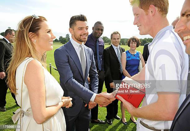 Tonya Meli Dominic Cooper and Prince Harry attend day 2 of the Audi Polo Challenge at Coworth Park Polo Club on August 4 2013 in Ascot England