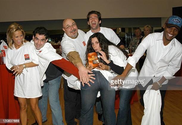 Tonya Paoni Jason Guy Gerry Lancaster Josh Feinberg Lisa Donahue Marcellas Reynolds give Danielle Reyes a swat