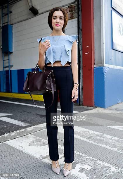 Tonya Papanikolas is seen outside the Jeremy Laing show wearing a Vida Vida top Zara pants YSL bag and Valentino heels on September 8 2013 in New...