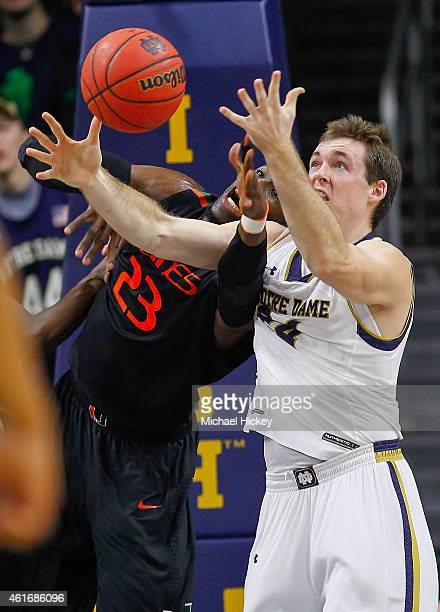 Tonye Jekiri of the Miami Hurricanes and Pat Connaughton of the Notre Dame Fighting Irish battle for a rebound at Purcell Pavilion on January 17 2015...