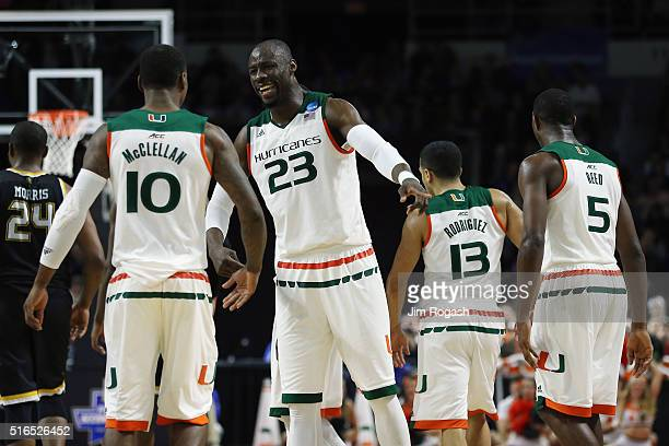 Tonye Jekiri of the Miami Hurricanes reacts with Sheldon McClellan in the second half against the Wichita State Shockers during the second round of...