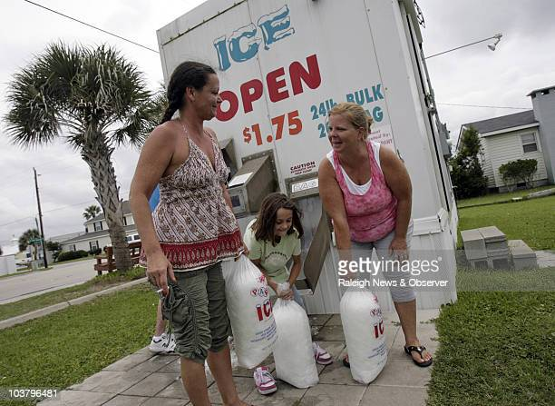 Tonyia Brown left Tessa Brown center and Karen Farmer stock up on ice from as they prepare for Hurricane Earl at Atlantic Beach North Carolina...
