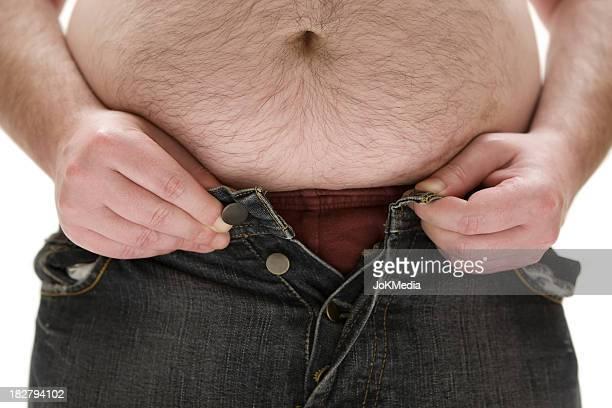 demasiada gordura para as suas calças - barriga de cerveja imagens e fotografias de stock