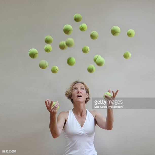 too many balls in the air - lisa strain stock pictures, royalty-free photos & images