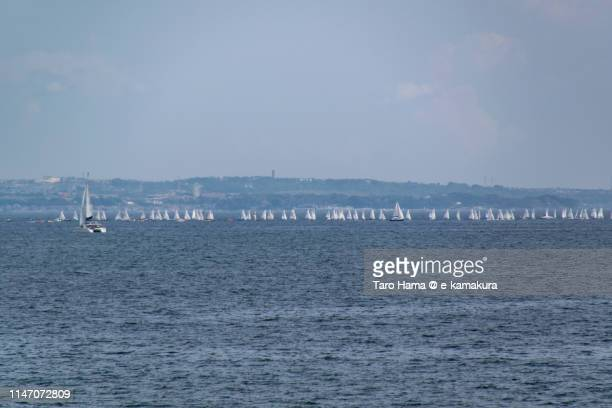 Too many yachts sailing on the beach in Japan