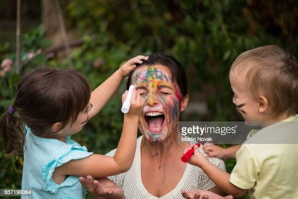 Too much creativity - children paint mother's face