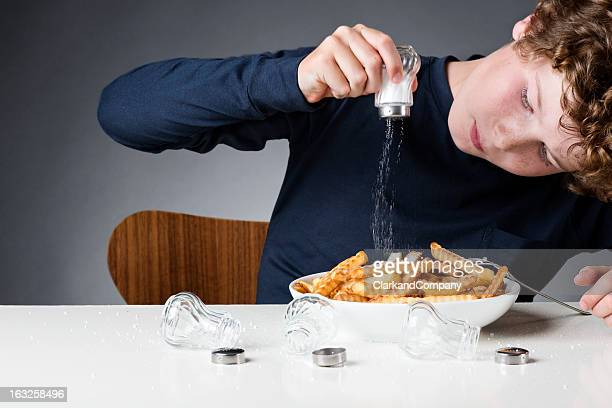 too much salt - sodium stock photos and pictures