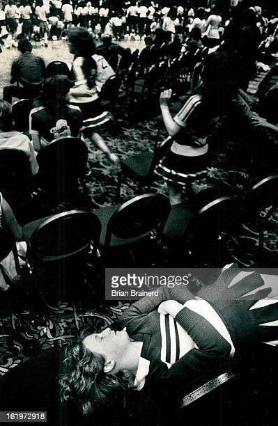 MAR 25 1984 MAR 26 1984 Too Pooped To Pom Kathy Magrogan a cheerleader at Machebuf High School gets some steep while cheerleaders from more than 50...