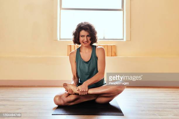 too soon to try that advanced yoga position? - negative emotion stock pictures, royalty-free photos & images