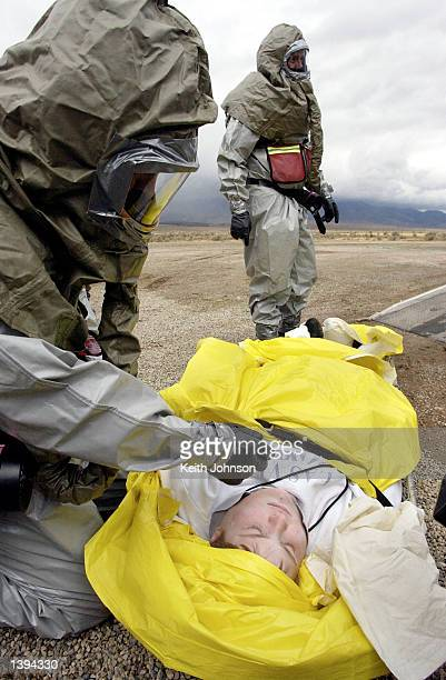 Tooele County Emergency Management personnel remove a 'victim' from a vehicle during an exercise simulating an accidental release of chemical agent...