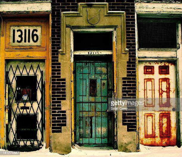 I took a wide shot of the entire block for a project I'm working on regarding abandoned businesses My daughter noticed the doors in the larger shot I...