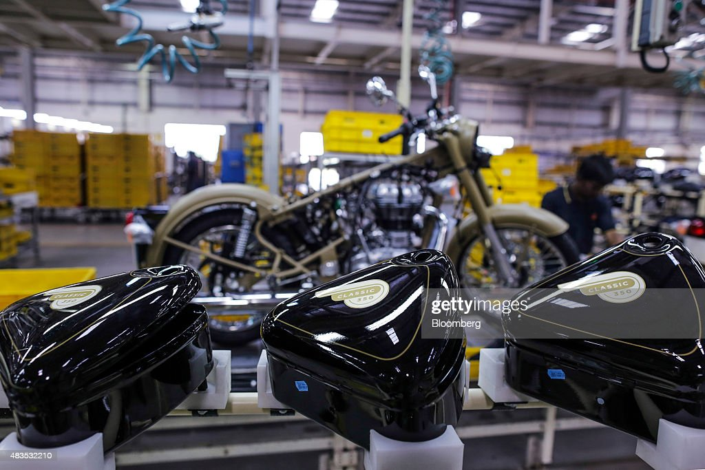 Tool boxes for the Royal Enfield Motors Ltd Classic 350 motorcycle sit on a rack on the production line at the company`s manufacturing facility in...