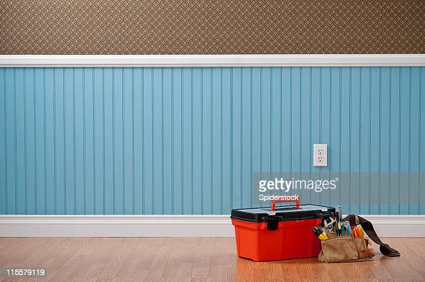 toolbox & toolbelt in empty room - toolbox stock photos and pictures
