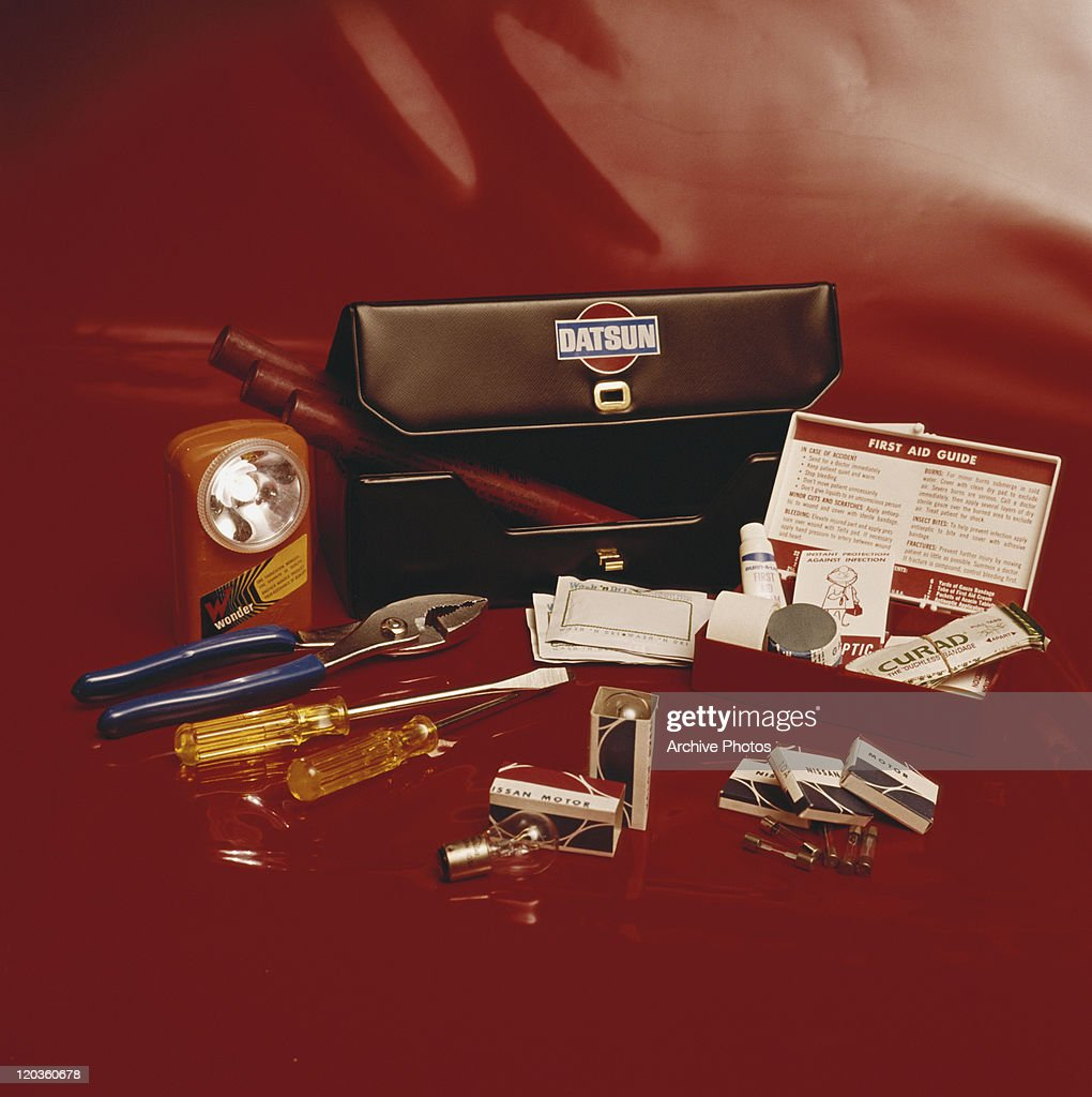 Toolbox with first aid kit on red background : Stock Photo