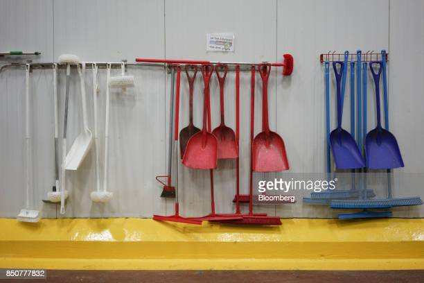 Tools and cleaning implements hang in a processing room at the Tulkoff Food Products Inc factory in Baltimore Maryland US on Tuesday Aug 29 2017...
