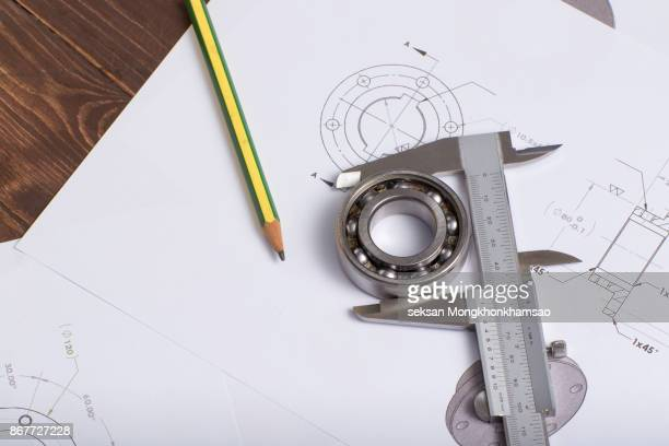 tools and mechanisms detail on the background of technical drawings - medir imagens e fotografias de stock