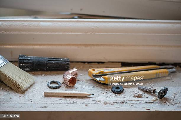 tools and parts on windowsill - utility knife stock photos and pictures