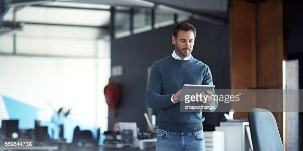 tools for the modern businessman - man in office stock photos and pictures