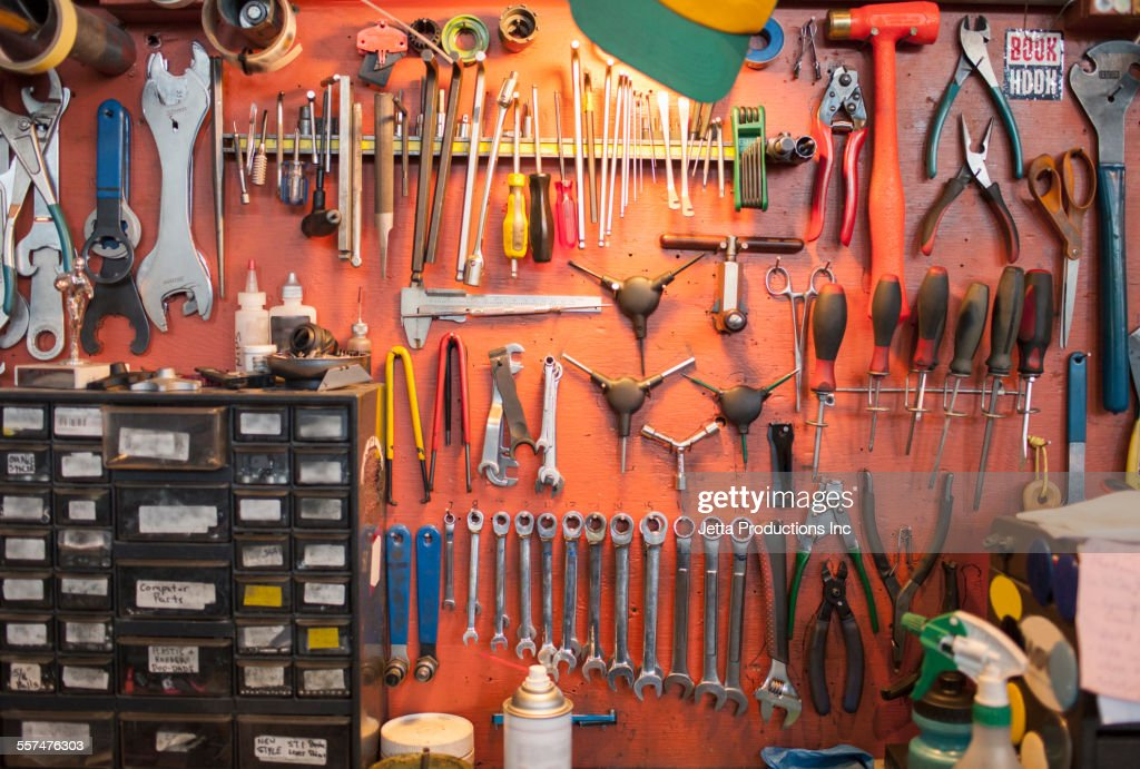 Tools Hanging From Bicycle Repair Shop Wall High