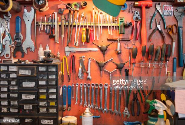 Tools hanging from bicycle repair shop wall