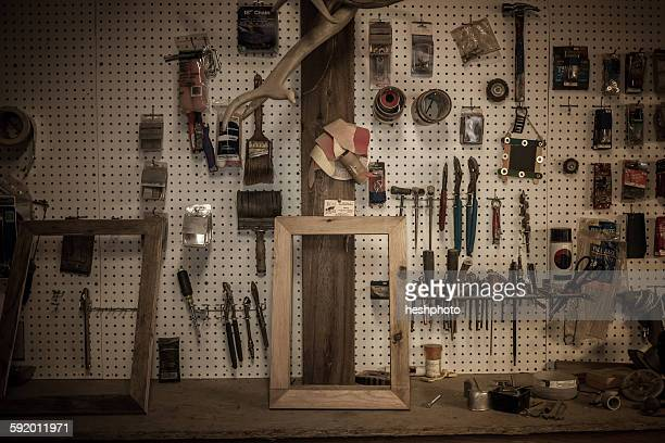 tools hanging in artists workshop - heshphoto stock pictures, royalty-free photos & images
