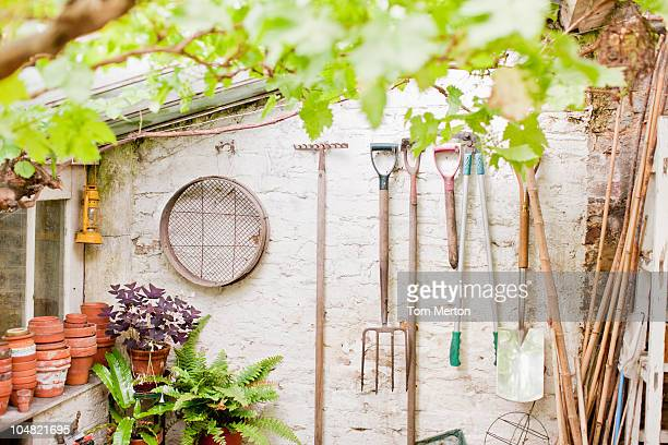 tools hanging on wall of garden shed - shed stock pictures, royalty-free photos & images