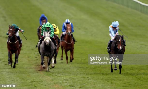 Toormore ridden by Ryan Moore beats the Grey Gatsby to win the Novae Bloodstock Insurance Craven Stakes during day two of the 2014 Craven Meeting at...