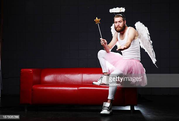 tooth fairy: with wand a molar - male angel stock photos and pictures