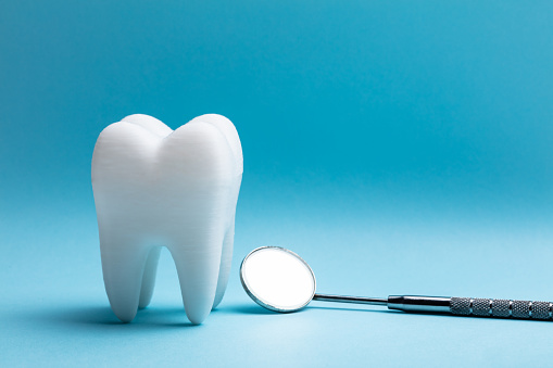 Tooth With Dental Mirror 1136317796