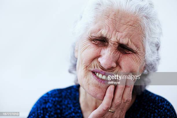 toothache - very ugly women stock photos and pictures