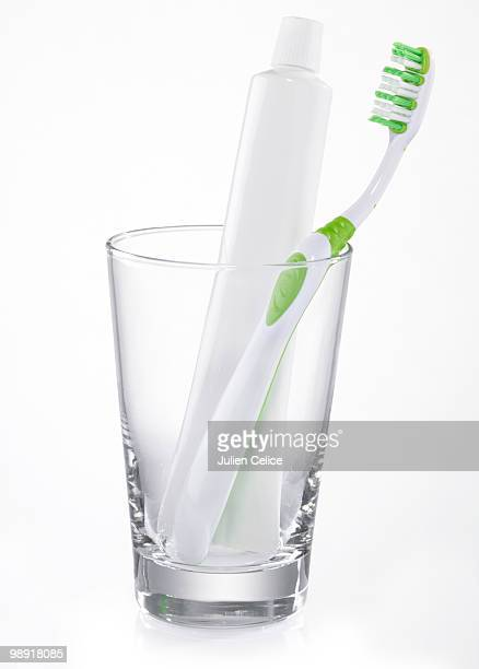 Toothbrush and toothpaste in a glass
