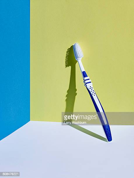 Toothbrush leaning on wall
