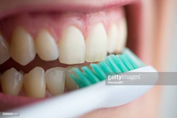 Toothbrush on teeth