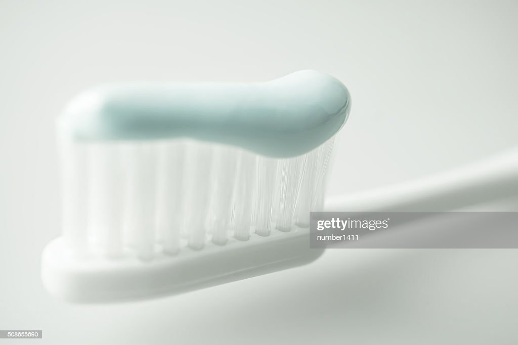 toothbrush with toothpaste in soft color : Stock Photo