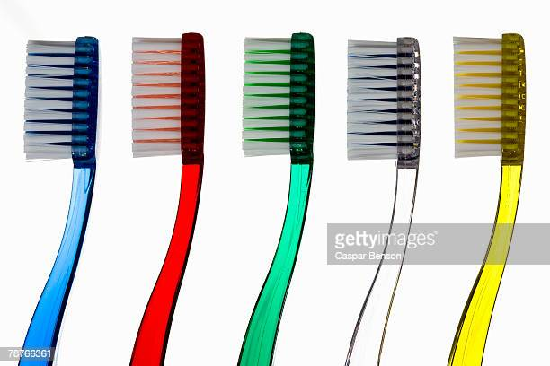 Toothbrushes in a row