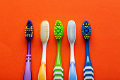 toothbrushes orange background concept toothbrush selection